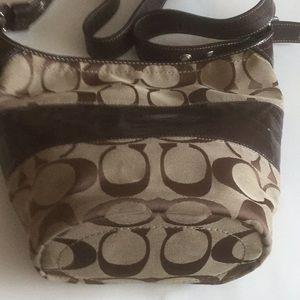 Coach shoulder bag. Adjustable shoulder strap.